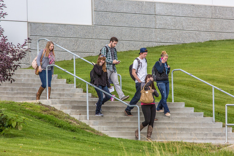"""Students leave the Reichardt Building after class on the first day of the 2013 fall semester.  <div class=""""ss-paypal-button"""">Filename: LIF-13-3928-40.jpg</div><div class=""""ss-paypal-button-end"""" style=""""""""></div>"""