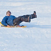 "Bryan Johnson spends some quality time on the UAF sledding hill on a nice February afternoon.  <div class=""ss-paypal-button"">Filename: LIF-12-3290-86.jpg</div><div class=""ss-paypal-button-end""></div>"