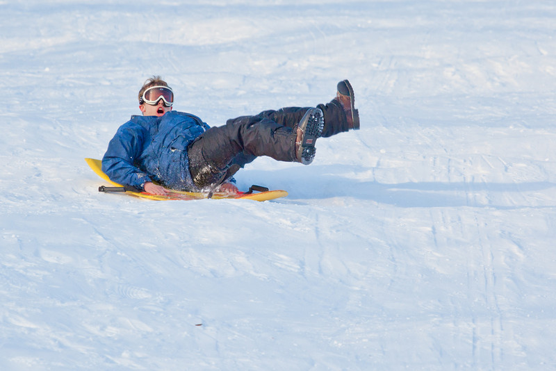 """Bryan Johnson spends some quality time on the UAF sledding hill on a nice February afternoon.  <div class=""""ss-paypal-button"""">Filename: LIF-12-3290-86.jpg</div><div class=""""ss-paypal-button-end"""" style=""""""""></div>"""