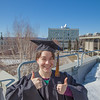 "Senior foreign languages major Lindsey Miller poses in her cap and gown on the roof of the Brooks Building on the Fairbanks campus.  <div class=""ss-paypal-button"">Filename: LIF-12-3352-70.jpg</div><div class=""ss-paypal-button-end"" style=""""></div>"