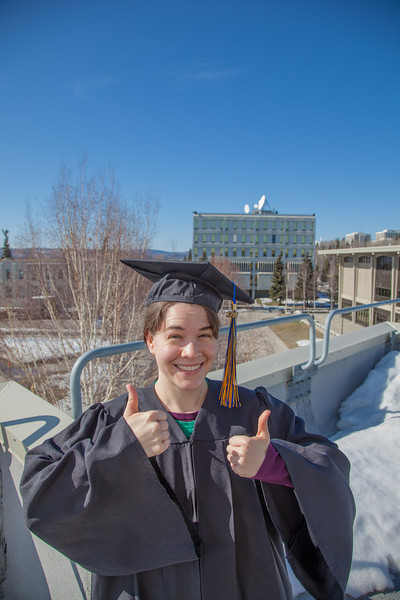 """Senior foreign languages major Lindsey Miller poses in her cap and gown on the roof of the Brooks Building on the Fairbanks campus.  <div class=""""ss-paypal-button"""">Filename: LIF-12-3352-70.jpg</div><div class=""""ss-paypal-button-end"""" style=""""""""></div>"""