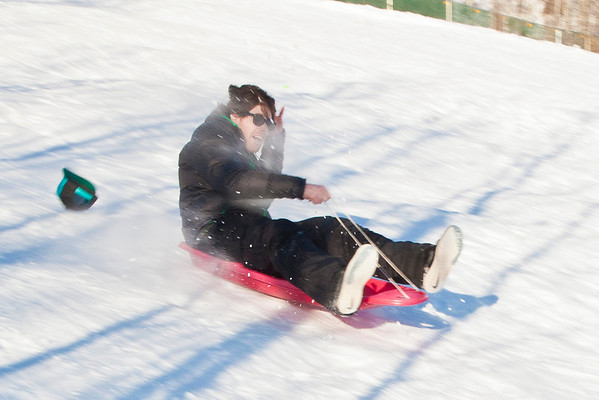 """Jimmy Donohue races down the sledding hill on campus.  <div class=""""ss-paypal-button"""">Filename: LIF-12-3289-29.jpg</div><div class=""""ss-paypal-button-end"""" style=""""""""></div>"""