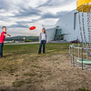 "Friends Aaron Druyvestein and Serena McCormick enjoy a round of disc golf on the campus course near the University of Alaska Museum of the North.  <div class=""ss-paypal-button"">Filename: LIF-14-4191-29.jpg</div><div class=""ss-paypal-button-end"" style=""""></div>"