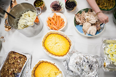 The ceramic tables, which usually are a workstation for student potters working with clay is transformed to a table spread, filled with delicious food at the annual Thanksgiving gathering at the ceramics department.  Filename: LIF-12-3660-57.jpg