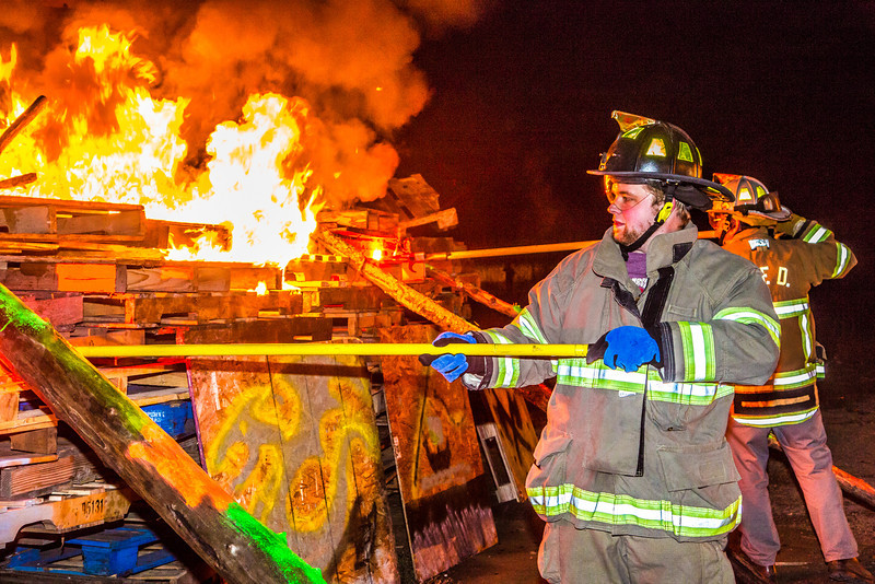 """Jared William Conrad joined Chancellor Rogers Saturday night in lighting the annual Starvation Gulch bonfires. Conrad won a drawing sponsored by UAF Traditions which allowed him the honor which is now bestowed upon a student each year.  <div class=""""ss-paypal-button"""">Filename: LIF-12-3571-101.jpg</div><div class=""""ss-paypal-button-end"""" style=""""""""></div>"""