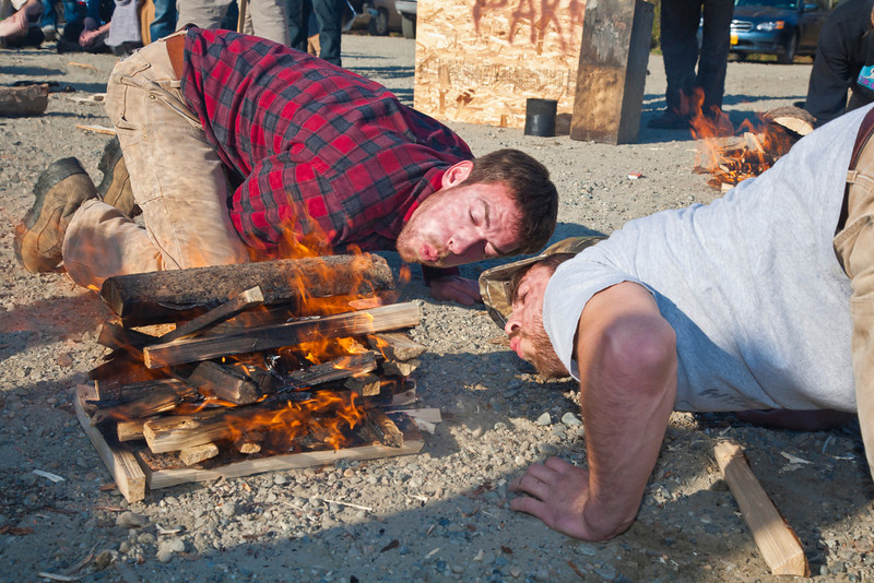 """Students Joe Hunner and Ethan Stephens team up for the fire building competition at the 2011 Farthest North Forest Sports Festival hosted by the UAF School of Natural Resources &amp; Agricultural Sciences.  <div class=""""ss-paypal-button"""">Filename: LIF-11-3185-215.jpg</div><div class=""""ss-paypal-button-end"""" style=""""""""></div>"""
