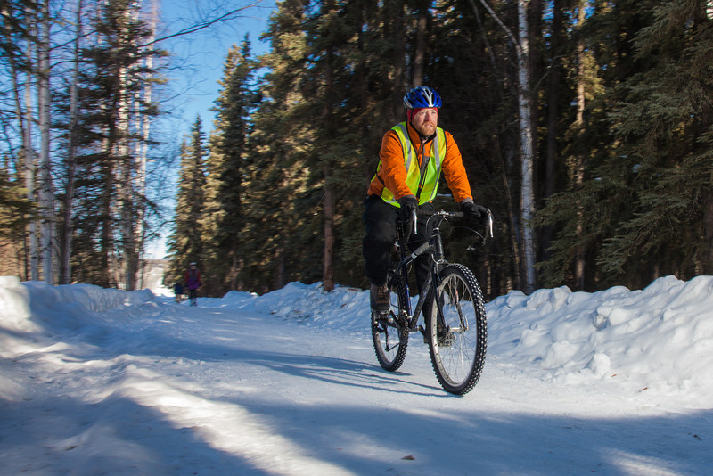"""Frank Olive, assisant coordinator of programming for UAF Outdoor Adventures, rides his bike to work on campus on a spring afternoon.  <div class=""""ss-paypal-button"""">Filename: LIF-12-3340-49.jpg</div><div class=""""ss-paypal-button-end"""" style=""""""""></div>"""