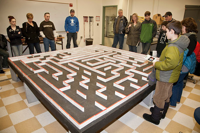 Families watch a mechanical mouse navigate through a maze during the annual Eweek open house in the Duckering Building on campus.  Filename: LIF-12-3302-24.jpg