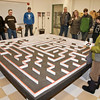"Families watch a mechanical mouse navigate through a maze during the annual Eweek open house in the Duckering Building on campus.  <div class=""ss-paypal-button"">Filename: LIF-12-3302-24.jpg</div><div class=""ss-paypal-button-end"" style=""""></div>"