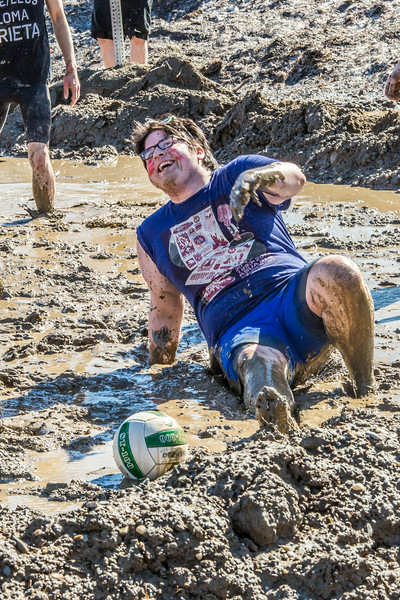 """A participant in the 2014 SpringFest mud volleyball bouts seems to enjoy the experience.  <div class=""""ss-paypal-button"""">Filename: LIF-14-4167-119.jpg</div><div class=""""ss-paypal-button-end""""></div>"""