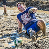 "A participant in the 2014 SpringFest mud volleyball bouts seems to enjoy the experience.  <div class=""ss-paypal-button"">Filename: LIF-14-4167-119.jpg</div><div class=""ss-paypal-button-end""></div>"