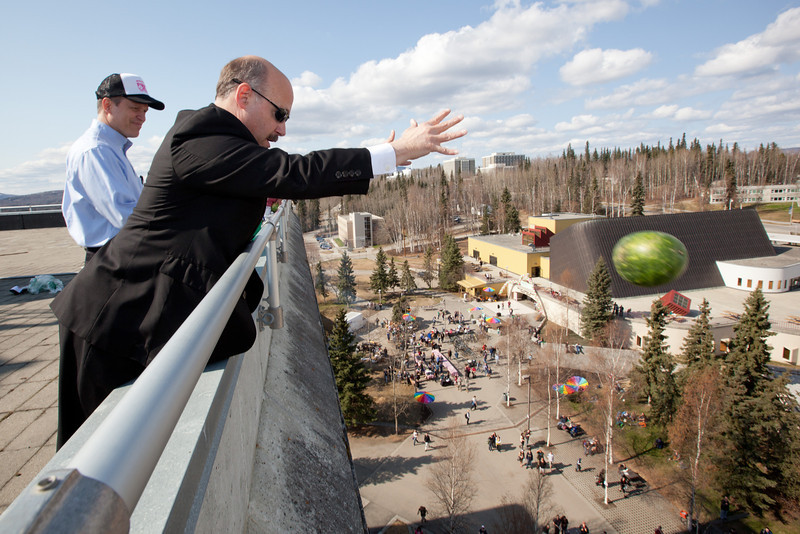 """Dr. Michael Sfraga chucks a watermelon from on top of Gruening Building during the 2012 Spring Fest's annual watermelon drop.  <div class=""""ss-paypal-button"""">Filename: LIF-12-3374-170.jpg</div><div class=""""ss-paypal-button-end"""" style=""""""""></div>"""