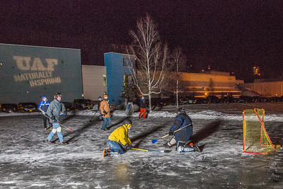 Outdoor broomball, played on the ice in front of the SRC, is a popular intramural sport at UAF.  Filename: LIF-12-3652-88.jpg