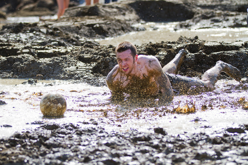 """Thomas Gerlach gets down during the mud volleyball tournament at the 2012 Spring Fest activities.  <div class=""""ss-paypal-button"""">Filename: LIF-12-3378-63.jpg</div><div class=""""ss-paypal-button-end"""" style=""""""""></div>"""