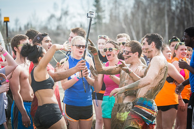 Particpants of the 2016 SpringFest mud volleyball tournament take a selfie during the games.  Filename: LIF-16-4879-330.jpg