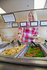 Junior Chelsea Fillingim loads up on vegetables during lunch in the Lola Tilly Commons.  Filename: LIF-11-3220-042.jpg