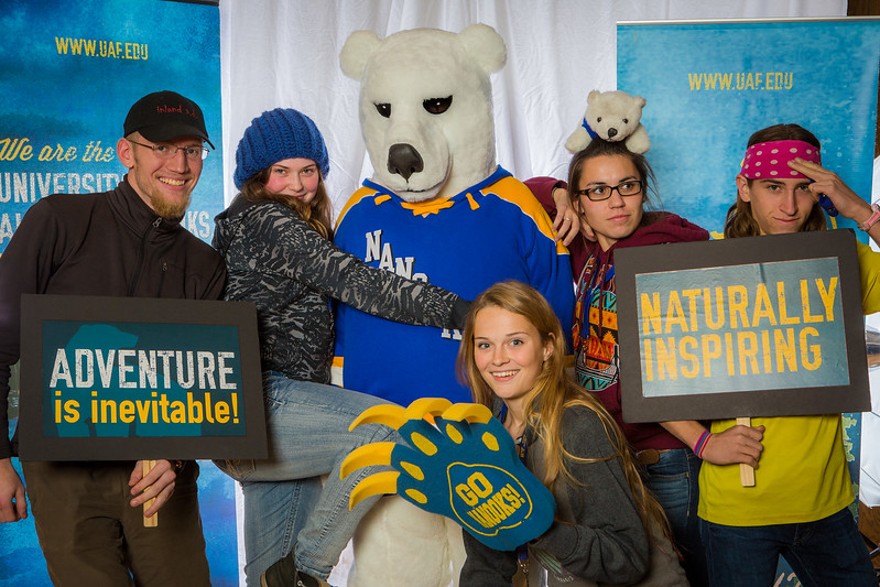 """Parents and prospective students pose with the UAF mascot during the Fall 2015 Inside Out event hosted by UAF's office of admissions and the registrar.  <div class=""""ss-paypal-button"""">Filename: LIF-14-4353-56.jpg</div><div class=""""ss-paypal-button-end""""></div>"""