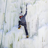 """Students take advantage of nice spring weather to try out their climbing skills on the new ice wall near the SRC.  <div class=""""ss-paypal-button"""">Filename: LIF-12-3321-067.jpg</div><div class=""""ss-paypal-button-end"""" style=""""""""></div>"""