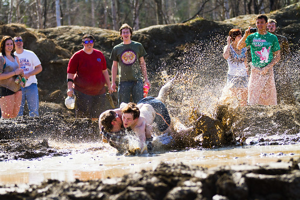 """Mickey Wilson takles a friend on the ground in between games during the 2012 Spring Fest mud volleyball tournament.  <div class=""""ss-paypal-button"""">Filename: LIF-12-3378-50.jpg</div><div class=""""ss-paypal-button-end"""" style=""""""""></div>"""