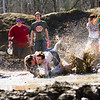 "Mickey Wilson takles a friend on the ground in between games during the 2012 Spring Fest mud volleyball tournament.  <div class=""ss-paypal-button"">Filename: LIF-12-3378-50.jpg</div><div class=""ss-paypal-button-end"" style=""""></div>"