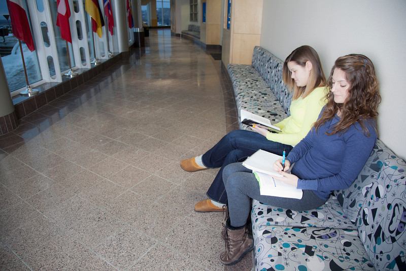 "Megan Gilmore (back) and Ashley Bartolowits (front) study in the hallway of the Syun-Ichi Akasofu building on campus.  <div class=""ss-paypal-button"">Filename: LIF-11-3242-019.jpg</div><div class=""ss-paypal-button-end"" style=""""></div>"
