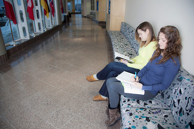 Megan Gilmore (back) and Ashley Bartolowits (front) study in the hallway of the Syun-Ichi Akasofu building on campus.  Filename: LIF-11-3242-019.jpg
