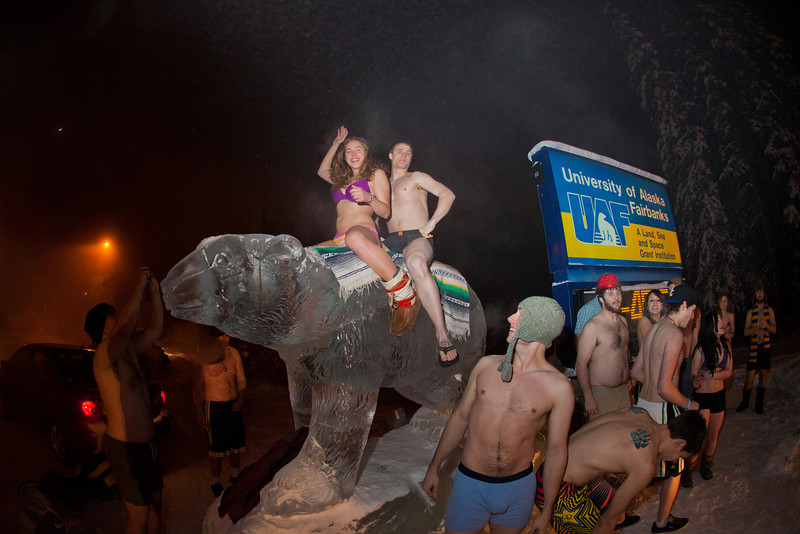 "A group of hardy UAF students join the 40° below club by posing in their shorts or swimsuits by the time &amp; temperature sign at an extreme temperature of 40° below or colder.  <div class=""ss-paypal-button"">Filename: LIF-12-3269-27.jpg</div><div class=""ss-paypal-button-end"" style=""""></div>"