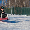 "Jimmy Donohue races down the sledding hill on campus.  <div class=""ss-paypal-button"">Filename: LIF-12-3289-65.jpg</div><div class=""ss-paypal-button-end"" style=""""></div>"