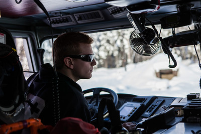 Spencer McLean drives Tender 11 to the University Fire Hall after filling an outdoor ice rink for children at Ice Alaska's George Horner Ice Park in Feb. 2013.  Filename: LIF-12-3723-25.jpg