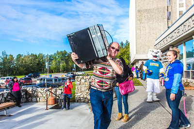 Returning students, staff and parents all pitch in to help new arrivals move into the residence halls during Rev It Up on the Fairbanks campus at the beginning of the fall 2015 semester.  Filename: LIF-15-4636-099.jpg