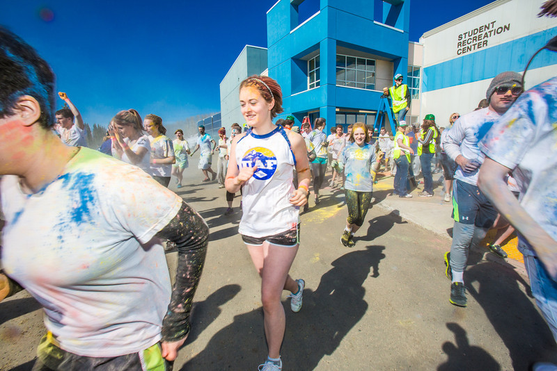 "Students enjoy getting doused with colored dye before participating in a 5-kilometer run during SpringFest on the Fairbanks campus.  <div class=""ss-paypal-button"">Filename: LIF-13-3805-88.jpg</div><div class=""ss-paypal-button-end"" style=""""></div>"