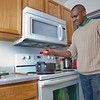 "Peter Ikewun, a petroleum engineeering graduate student from Nigeria, prepares a traditional African soup in his communal Wickersham Hall kitchen.  <div class=""ss-paypal-button"">Filename: LIF-12-3268-023.jpg</div><div class=""ss-paypal-button-end"" style=""""></div>"
