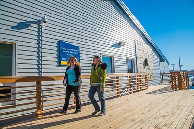 Students Alyssa Wols, left, and Marjorie Tahbone walk between buildings at UAF's Northwest Campus in Nome.  Filename: LIF-16-4865-247.jpg