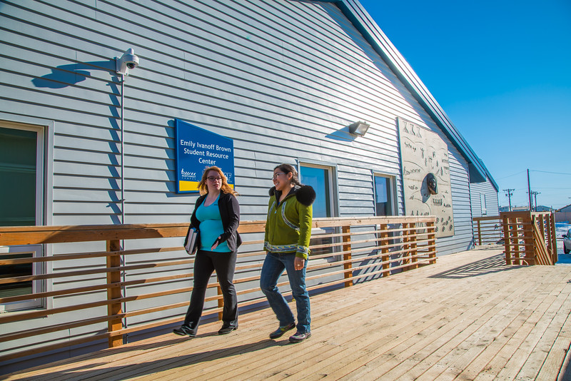 "Students Alyssa Wols, left, and Marjorie Tahbone walk between buildings at UAF's Northwest Campus in Nome.  <div class=""ss-paypal-button"">Filename: LIF-16-4865-247.jpg</div><div class=""ss-paypal-button-end""></div>"