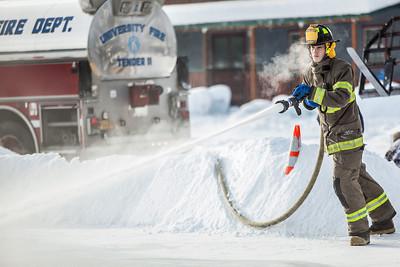 Aaron Stevens fills an outdoor ice rink for children at Ice Alaska's George Horner Ice Park in Feb. 2013.  Filename: LIF-12-3723-189.jpg