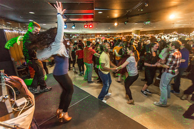 Students learn some new steps during a Latin Dance evening in the Wood Center Pub, one of many events in the 2014 UAF Winter Carnival.  Filename: LIF-14-4086-17.jpg