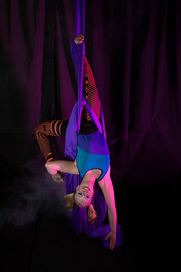 Teal Rogers is an active member of the silk club at UAF, in which members perform acrobatic stunts hanging from silks.  Filename: LIF-14-4133-261.jpg
