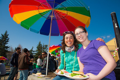 Theresia Schnurr (left)and Terilyn Lawson (right) eat lunch in front of the Wood Center on campus during the Spring Fest kick off barbeque.  Filename: LIF-12-3375-46.jpg