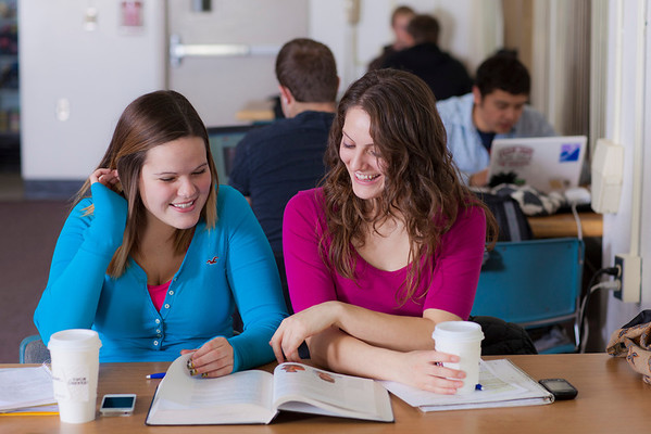 """UAF students Megan Gilmore and Ashley Bartolowits sit with their cofee and study materials in the 24-hour study area of the Rasmuson Library.  <div class=""""ss-paypal-button"""">Filename: LIF-11-3212-165.jpg</div><div class=""""ss-paypal-button-end"""" style=""""""""></div>"""