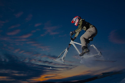 Engineering major Mike Stanfill tests out his modified ski-bike on the UAF sledding hill.  Filename: LIF-12-3305-3.jpg