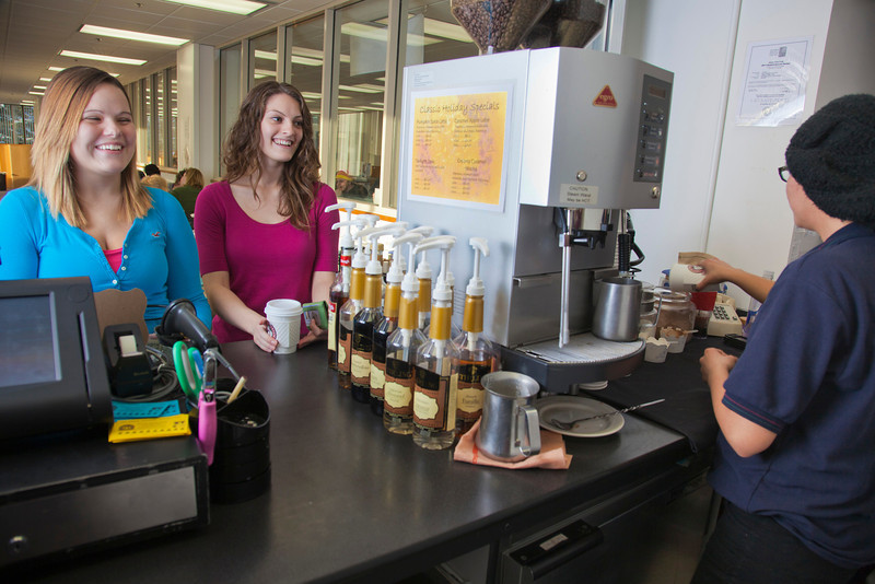 "UAF students Megan Gilmore (left) and Ashley Bartolowits (right) order warm drinks from the snack stand in 24 hour study area of the Rasmuson Library.  <div class=""ss-paypal-button"">Filename: LIF-11-3212-010.jpg</div><div class=""ss-paypal-button-end"" style=""""></div>"