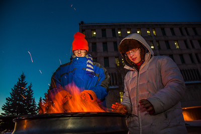 Mathew Carrick and Sarah Azrael take their turn at the Honors Program homeless vigil Friday morning while the temperature hovered around -20°.  Filename: LIF-12-3653-11.jpg