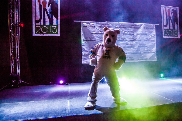 """The Nanook mascot strikes a pose on the stage at the beginning of  an after-dinner dance for athletes competing in the Junior Nationals Cross-Country Ski Championships March 16 in the SRC.  <div class=""""ss-paypal-button"""">Filename: LIF-13-3761-86.jpg</div><div class=""""ss-paypal-button-end"""" style=""""""""></div>"""