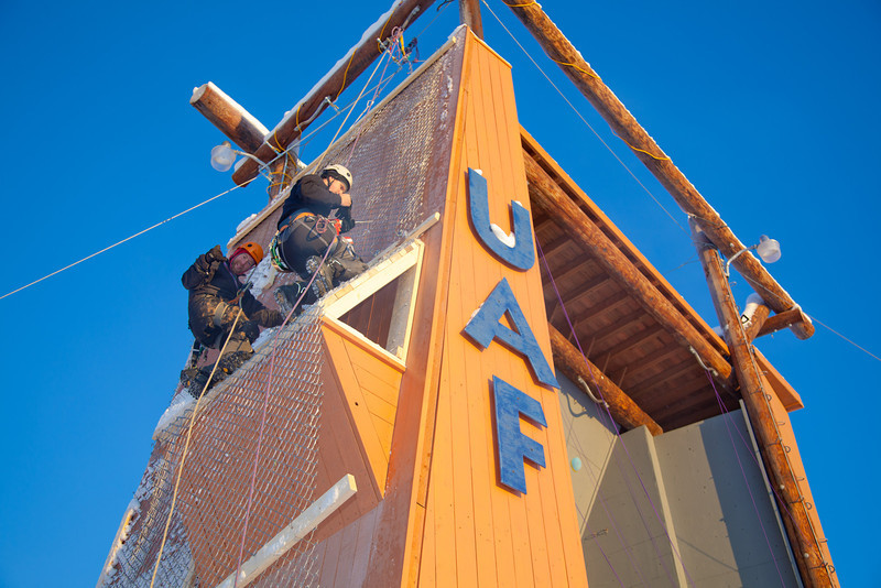 "Outdoor Adventure managers Frank Olive, left, and Mark Oldmixon prepare the west wall of the outdoor climbing tower for a season of ice climbing.  <div class=""ss-paypal-button"">Filename: LIF-11-3237-01.jpg</div><div class=""ss-paypal-button-end"" style=""""></div>"