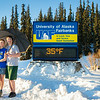 "Sporting shorts and a t-shirt in above freezing temperatures in January, Megan Lasselle and Seth Reddell pose for a portrait at the time and temperature sign.  <div class=""ss-paypal-button"">Filename: LIF-14-4047-38.jpg</div><div class=""ss-paypal-button-end""></div>"