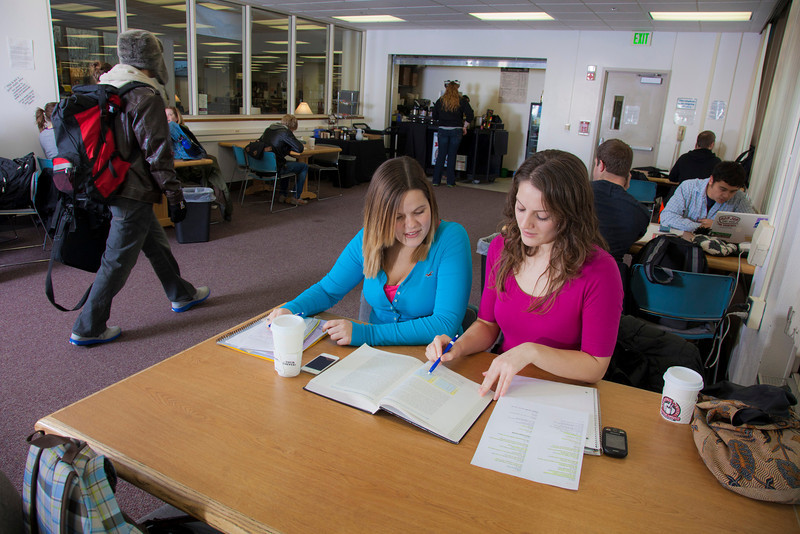 "UAF students Megan Gilmore and Ashley Bartolowits sit with their cofee and study materials in the 24-hour study area of the Rasmuson Library.  <div class=""ss-paypal-button"">Filename: LIF-11-3212-128.jpg</div><div class=""ss-paypal-button-end"" style=""""></div>"