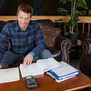 """Joe Hunner studies in the lounge on the upper level of the Wood Center on campus.  <div class=""""ss-paypal-button"""">Filename: LIF-11-3190-02.jpg</div><div class=""""ss-paypal-button-end"""" style=""""""""></div>"""