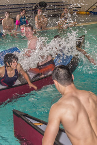 Battleship is a popular intramural sport at UAF. Teams in canoes try to swamp each other's boats during a tournament in the Patty pool.  Filename: LIF-13-3975-22.jpg
