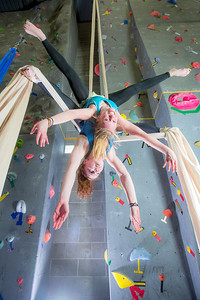 Undergraduates Miriam Brooks, bottom, and Teal Rogers practice their silk climbing skills in the SRC.  Filename: LIF-13-3819-227.jpg
