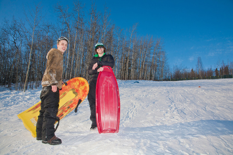 """Bryan Johnson (left) and Jimmy Donohue (right) stop sledding for a picture on the SRC Hill on a sunny day in February.  <div class=""""ss-paypal-button"""">Filename: LIF-12-3289-102.jpg</div><div class=""""ss-paypal-button-end"""" style=""""""""></div>"""